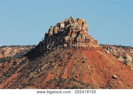 A Beautifully Eroded Red Mountain Contrasting With A Clear Deep Blue Sky.  Photographed While Hiking