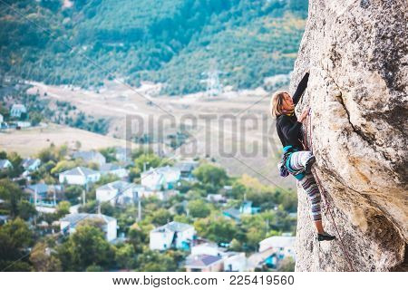 The Girl Climbs The Rock.