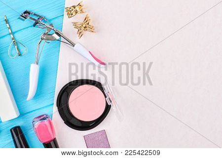Eyelashes Curler And Beauty Accesories. Set Of Cosmetics And Copy Space, Top View. Make Up Equipment