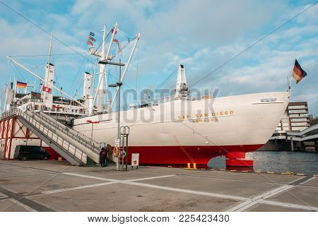 Hamburg, Germany - January 2018. A Ship Standing On The Dock With A Gangway And A German Flag On Its