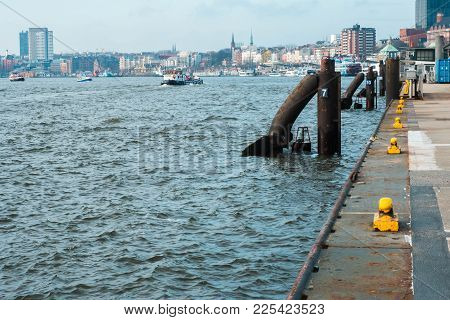 Hamburg, Germany - January 2018. River Elbe With Pier For Ships And Boats Against The Backdrop Of Th