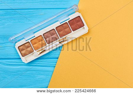 Brown Eyeshadows Palette, Top View. Set Of Beige And Brown Eyeshadows On Colorful Background. High Q
