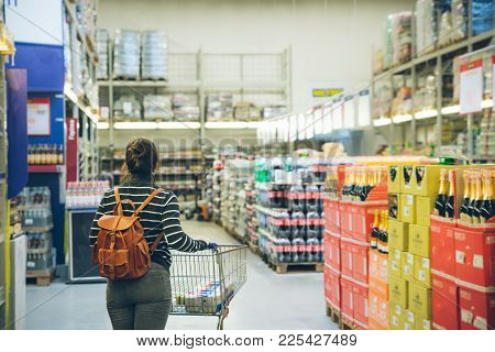 Woman Walk By Store With Cart Seek For Products
