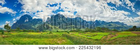 Fields and mountains. Beautiful rural landscape. Vang Vieng, Laos. Panorama