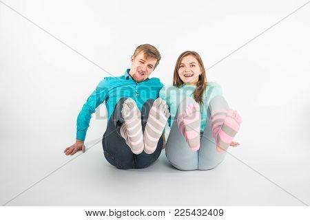 Portrait Funny Moments Of Excited Couple Fooling Around To Camera On White Background. Having Fun, W