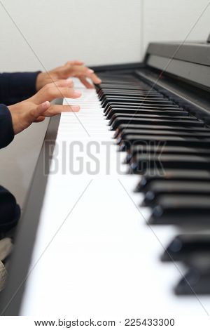 Hands Of Japanese Boy Playing A Piano (second Grade At Elementary School)