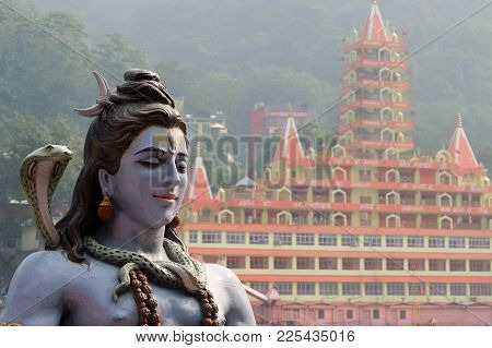 Rishikesh, India - November, 3rd, 2017 Statue Of Shiva Sitting In Meditation On The Riverbank Of Gan