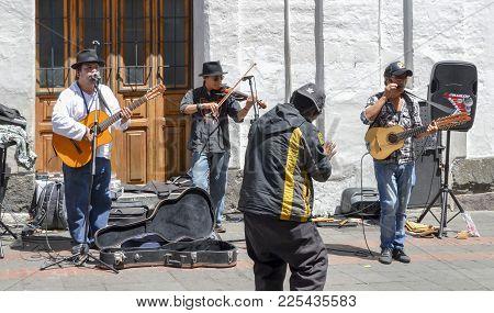 Quito, Ecuador, December 17, 2017: Music Street Performers In The Historic Centre Of Quito, Ecuador