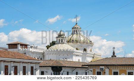 The Domes Of Santo Domingo Church In The City Of Quito In Ecuador, South America.