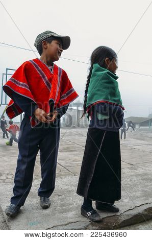 Tungurahua, Ecuador - Dec 20, 2017: Young Ecuadorian Indigenous Schoolboy And Schoolgirl Pose For A