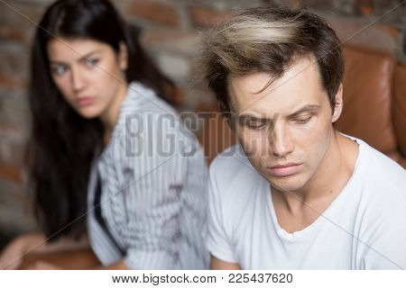 Young Sad Cheated Man Thinking Of Betrayal Unresolved Problem In Bad Relationship, Upset Girlfriend