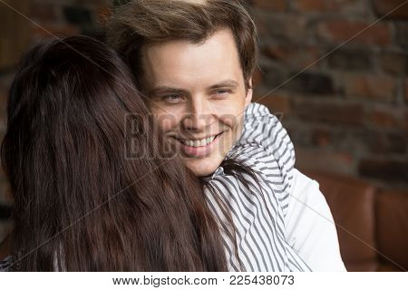 Young Sly Liar Man Happily Smiling While Woman Embracing Him, Dishonest Cheating Boyfriend Womanizer