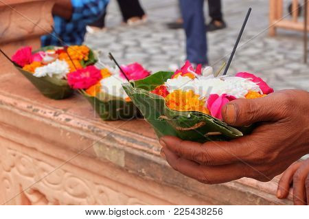 Flowers For Ganga Aarti Ceremony In Parmarth Niketan Ashram At Sunset. Rishikesh Is World Capital Of