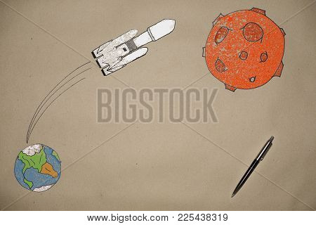 Drawing The Launch Of A Rocket Falcon To Mars On The Background Of The Earth Made On Craft Paper, Am