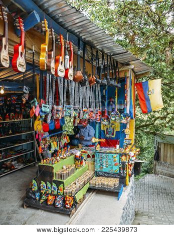 Banos, Ecuador - December 24th, 2017: Stand Where Local Indigenous Ecuadorian Man Sells Local Handic