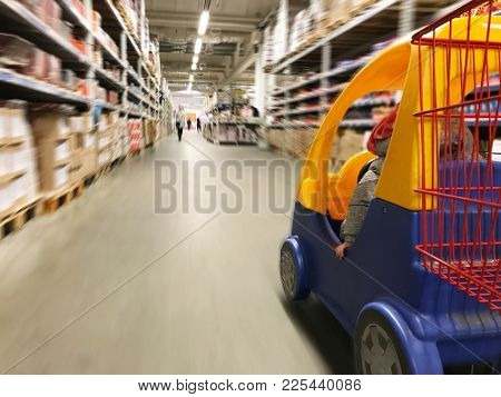 supermarket shopping cart view with supermarket aisle motion blur