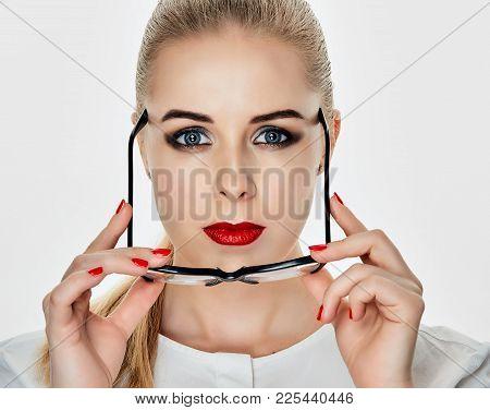Serious Girl Holding Glasses On White Background