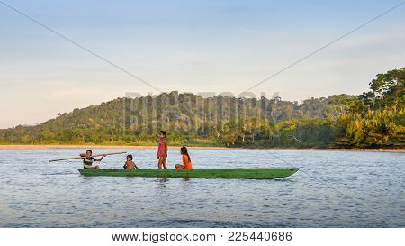 Ecuadorian Amazon, December 31st 2017: Local Quechua Tribe Teenagers In The Ecuadorian Amazon On A C