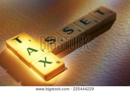 Cleckheaton, West Yorkshire, Uk: Scrabble Board Game Letters Spelling The Words Tax Asset, 1st June
