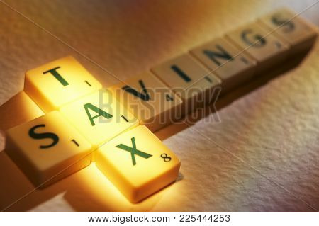 Cleckheaton, West Yorkshire, Uk: Scrabble Board Game Letters Spelling The Words Tax Savings, 1st Jun