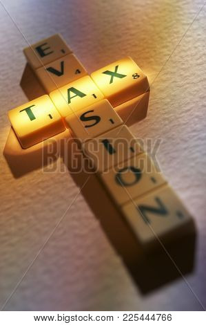 Cleckheaton, West Yorkshire, Uk: Scrabble Board Game Letters Spelling The Words Tax Evasion, 1st Jun