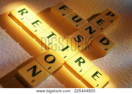 Cleckheaton, West Yorkshire, Uk: Scrabble Board Game Letters Spelling The Words Pension Fund Retire,