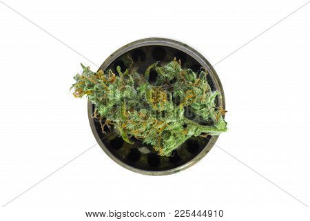 Metallic Gray Grinder With Buds Of Marijuana, Weed Cannabis Isolated On White Background Top View Me