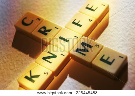 Cleckheaton, West Yorkshire, Uk: Scrabble Board Game Letters Spelling The Words Knife Crime, 1st Jun