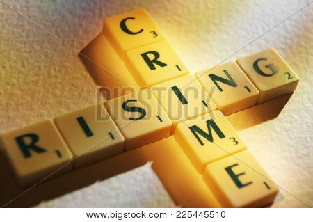 Cleckheaton, West Yorkshire, Uk: Scrabble Board Game Letters Spelling The Words Crime Rising, 1st Ju