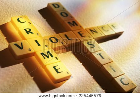 Cleckheaton, West Yorkshire, Uk: Scrabble Board Game Letters Spelling The Words Crime Domestic Viole