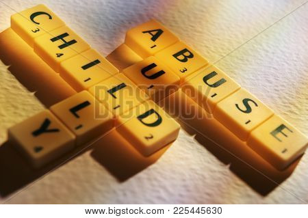 Cleckheaton, West Yorkshire, Uk: Scrabble Board Game Letters Spelling The Words Child Abuse Bully, 1