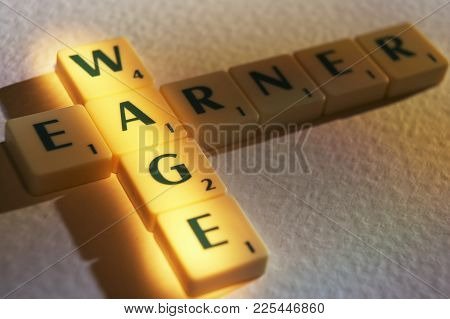 Cleckheaton, West Yorkshire, Uk: Scrabble Board Game Letters Spelling The Words Wage Earner, 1st Jun