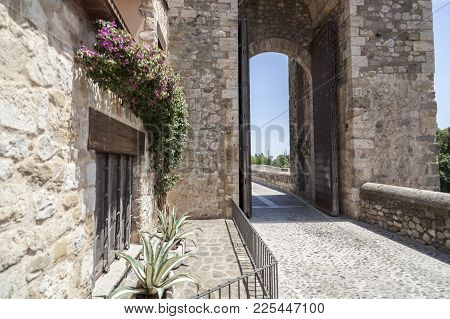 Besalu,spain-may 17,2017:street View And Tower Arch Of Romanesque Bridge In Medieval Village Of Besa