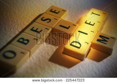 Cleckheaton, West Yorkshire, Uk: Scrabble Board Game Letters Spelling The Words Obese Slim Diet, 1st