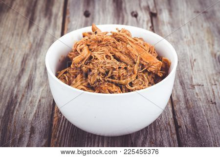 Delicious Bbq Pulled Pork Bowl Over A Wooden Plank Table