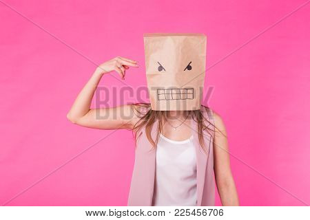 Concept Of Negative Emotions - Angry Woman With A Paper Bag On His Face