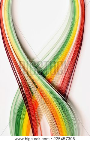 Yellow, Green, Orange And Red Paper Stripes On White Background; Abstract Lines Background