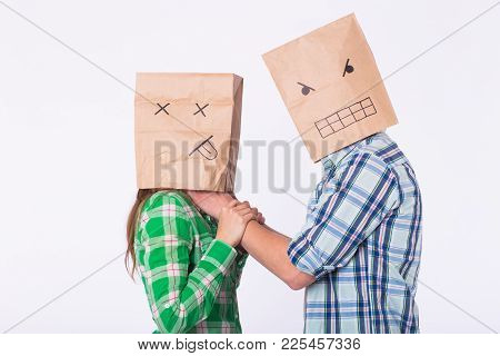Violence Against Woman. Aggressive Man With Bag On Head Strangling His Woman. Negative Relations In