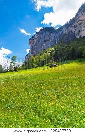 View Of Alpine Valley And Mountains. Sunny Spring Day In Alps. Chalets On Green Mountain Slope. Swis
