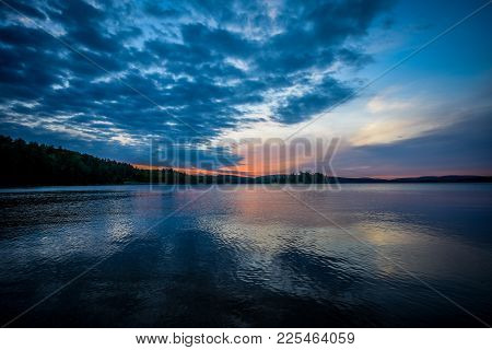 Sunrise Over A Calm Lake In Northern Ontario, Canada.
