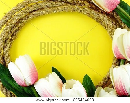 Space Background For Copy With Robe Border And Artificial Tulip Flowers Decor