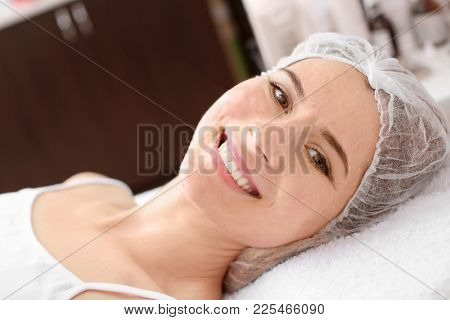Young woman after biorevitalization procedure in salon