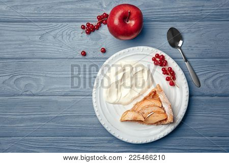 Composition with piece of tasty apple tart on table, top view