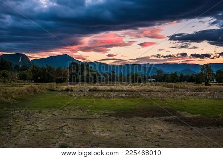 Beautiful View Of Rural Green Rice Field During Sunrise Background At Nakhon Nayok Province, Thailan