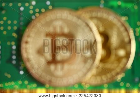 Close Up Of Golden Bitcoin With Green Circuit Board