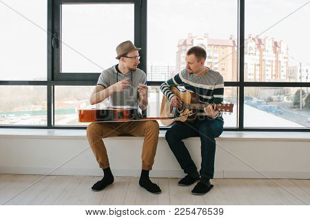 Learning To Play The Guitar. Music Education And Extracurricular Lessons. Hobbies And Enthusiasm For