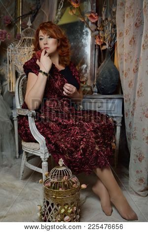 Curvy Red Head Witch In Beautiful Evening Dress