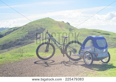 Biking In The Hills With Toddler In Child Trailer Or Carrier, Family Hike