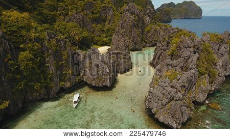 Tropical Lagoon With Turquoise Water And White Sand. Blue Lagoon With Tourists And Motor Boats. Beau