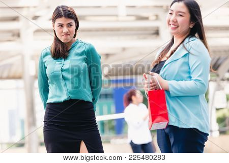 Asian Woman Envious Her Friend With Shopping Bags